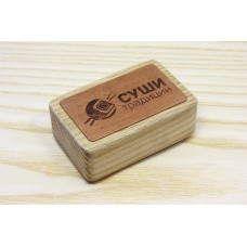 Stamp logo on a wooden bar with engraving