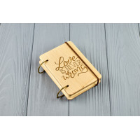 "Pocket notebook made of wood A7 on rings ""Love is never wrong"""